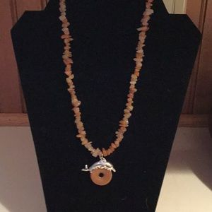 Jewelry - Handcrafted agate necklace with dolphin bail.